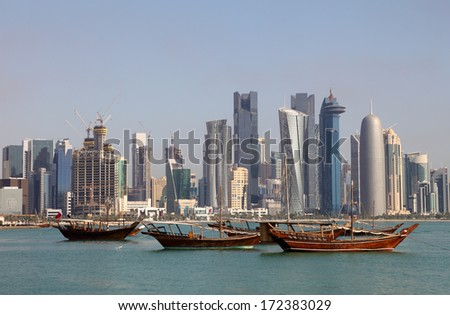 Skyline of Doha with traditional arabic dhows. Qatar, Middle East - stock photo