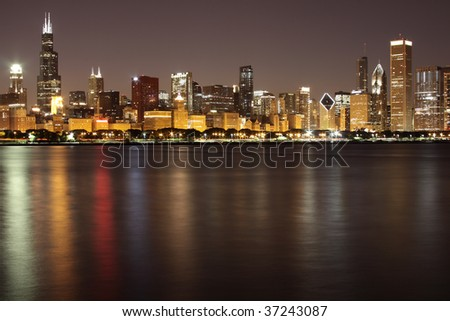 Skyline of Downtown Chicago across Lake Michigan after sunset. The Loop. - stock photo