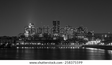 Skyline of Downtown Montreal at night view from Pierre-Dupuy Sreet B/W picture. - stock photo