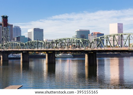 Skyline of downtown Portland Oregon with highrise buildings on the waterfront. - stock photo