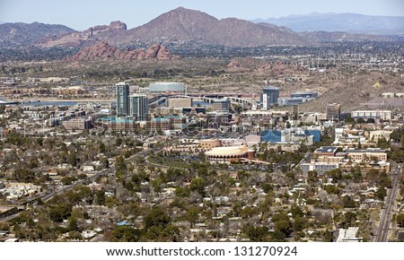 Skyline of downtown Tempe, Arizona with the Papago Buttes and Camelback Mountain in the distance