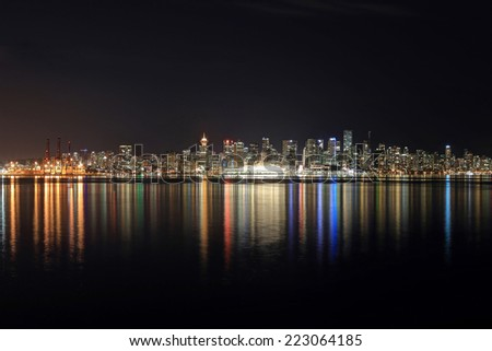 Skyline of Downtown Vancouver at night - stock photo
