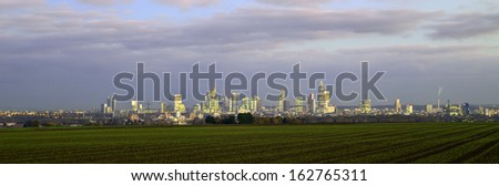 skyline of Frankfurt by night with clouds and skyscraper - stock photo