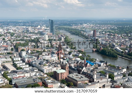 Skyline of Frankfurt city in Germany early  in the evening  with skyscrapers and the river Rhine - stock photo