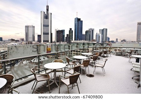 Skyline of Frankfurt in early morning covered with fresh snow - stock photo