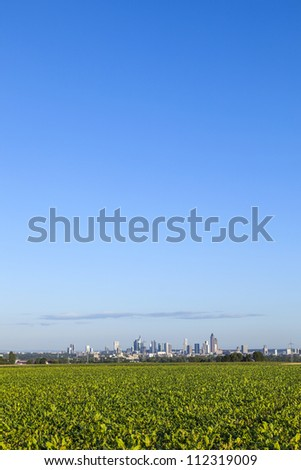 skyline of Frankfurt with fields in foreground - stock photo