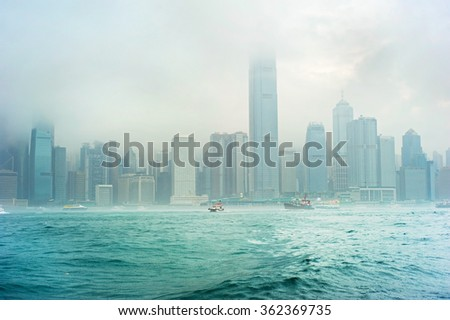 Skyline of Hong Kong in the fog during the rain - stock photo