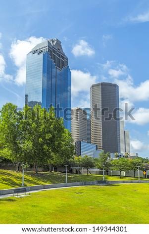 Skyline of Houston, Texas in daytime under blue sky - stock photo