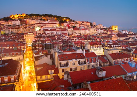 Skyline of Lisbon Old Town at dusk. Aerial view. Portugal - stock photo