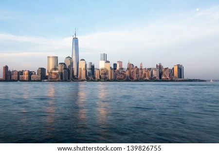 Skyline of lower Manhattan of New York City from Exchange Place at dusk with World Trade Center at full height of 1776 feet May 2013 - stock photo