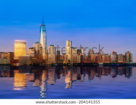 Skyline of lower Manhattan of New York City from Exchange Place at night with World Trade Center at full height of 1776 feet - stock photo