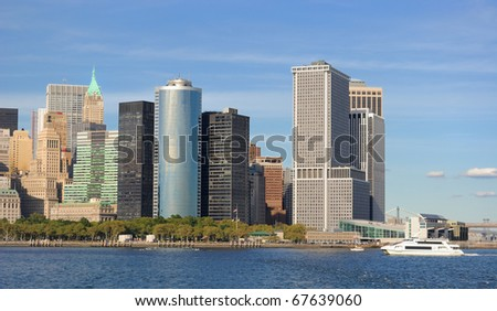 Skyline of Lower Manhattan's FInancial District and boats from New York Harbor.