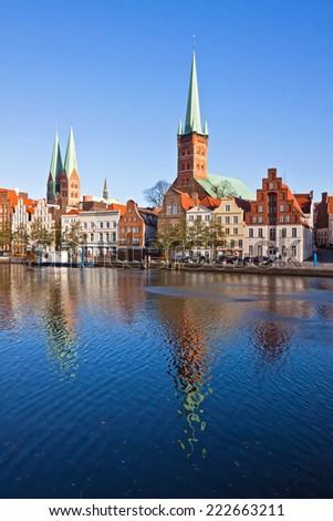 Skyline of Lubeck old town with Marienkirche (St. Mary's Church) and Petrikirche (St. Peter's Church) reflected in Trave river, Germany