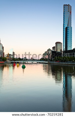 Skyline of Melbourne and the Yara River at dawn - stock photo