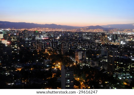 Skyline of Mexico City just after sunset, shot from Colonio Polanco district towards northwest. The sky is unusually clear and free of smog. - stock photo
