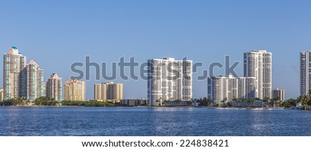 skyline of Miami with ocean under blue sky