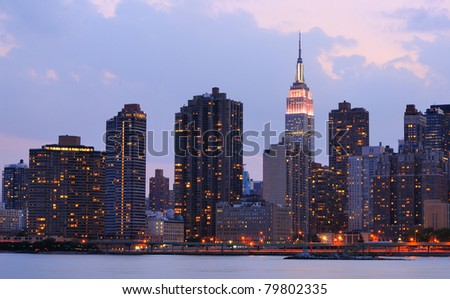 Skyline of Midtown Manhattan from across the East River including the Empire State Building - stock photo