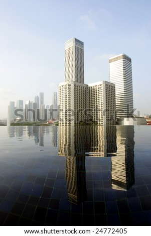 Skyline of modern business district over infinity pool, Singapore - stock photo