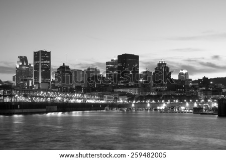 Skyline of Montreal, View from the Pierre-Dupuy street behind the river, in the black and white picture. - stock photo