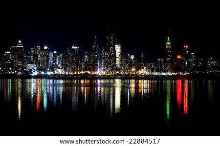Skyline of New York City at night, from New Jersey - stock photo