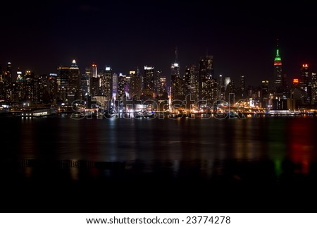 Skyline of New York City, at night, from New Jersey. - stock photo