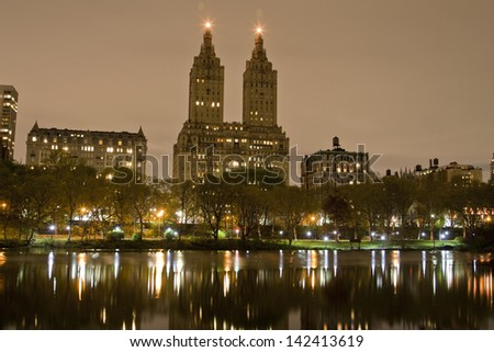 Skyline of NYC on a cold spring NYC night from Central Park. - stock photo