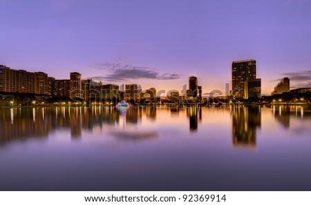Skyline of Orlando, Florida at Lake Eola. - stock photo