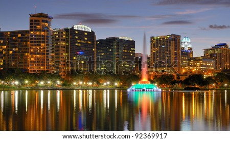 Skyline of Orlando, Florida at Lake Eola. - stock photo