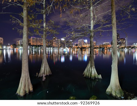 Skyline of Orlando, Florida from lake Eola. - stock photo