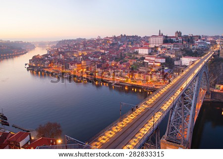 Skyline of Porto with famous Dom Luis Bridge, Portugal  - stock photo