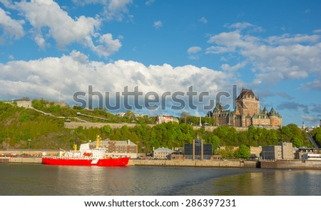 Skyline of Quebec city (a UNESCO World Heritage site) shot from saint Lawrence river including the Citadel and Chateau Frontenac a historic hotel and landmark in Canada. - stock photo