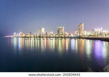Skyline of Salmiya at night. Kuwait City, Middle East - stock photo