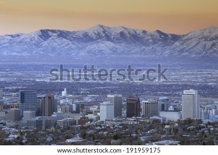 Skyline of Salt Lake City, UT with Snow capped Wasatch Mountains in background - stock photo