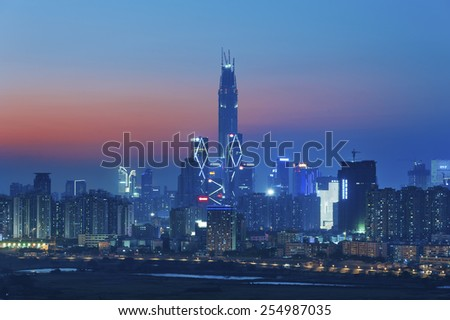 Skyline of Shenzhen City, China at twilight. Viewed from Hong Ko - stock photo
