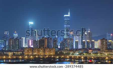 Skyline of Shenzhen City, China at twilight. Viewed from Hong Kong Border