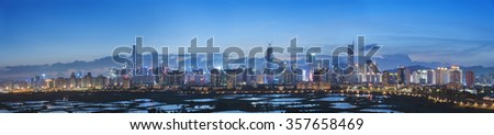 Skyline of Shenzhen City, China at twilight. Viewed from Hong Kong border - stock photo
