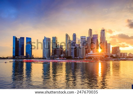 Skyline of Singapore at a beautiful sunset - stock photo