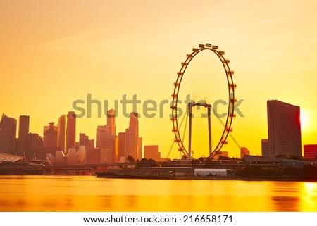 Skyline of Singapore at the golden sunset  - stock photo