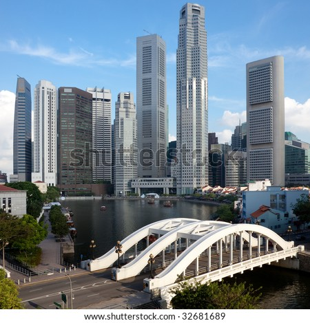 Skyline of Singapore financial district framed by Elgin Bridge and the Singapore River - stock photo