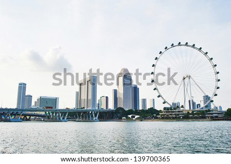 Skyline of Singapore with Flyer and modern buildings - stock photo