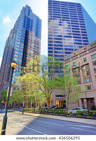 Skyline of skyscrapers in the City Center of Philadelphia, Pennsylvania, the USA. It is a central business district in Philadelphia. Tourists on the square. - stock photo