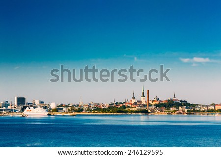 Skyline Of Tallinn And Harbour, Coast With Blue Clear Sky At Sunrise, Estonia. View From Sea, Gulf Of Finland - stock photo