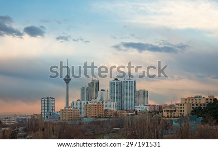 Skyline of Tehran with Milad Tower among high rise buildings. - stock photo