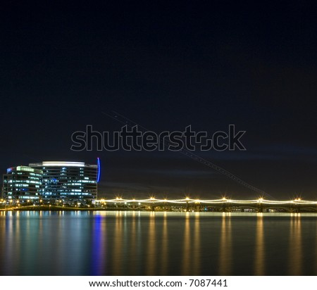 Skyline of Tempe Arizona photographed at night with reflections in lake - stock photo