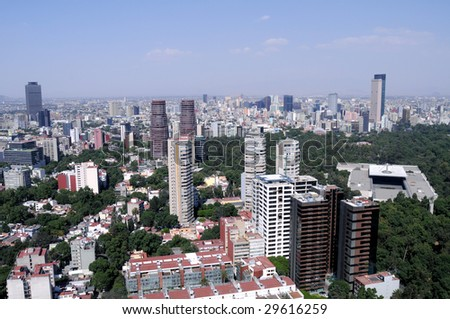 Skyline of the financial center of Mexico City. On the right Torre Mayor, the highest skyscraper in Latin America, below it is Museo Rufino Tamayo in Chapultepec Park. - stock photo