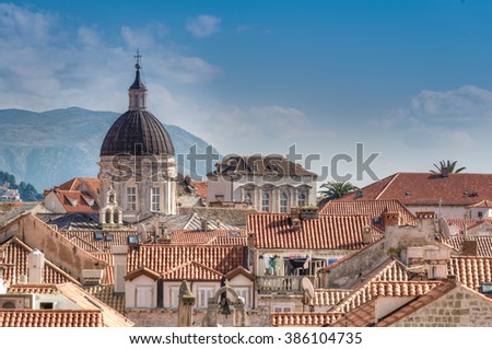 Skyline of the old town of Dubrovnik with its red tiled roofs and the Assumption Cathedral, Dubrovnik, Croatia - stock photo