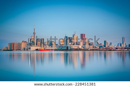 Skyline of Toronto over Ontario Lake at sunrise - stock photo