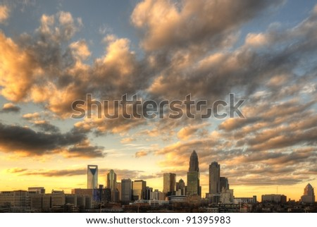 Skyline of Uptown Charlotte, North Carolina under dramatic cloud cover. - stock photo