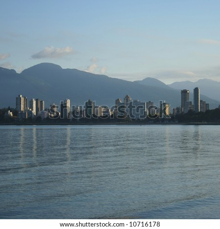 skyline of Vancouver condominiums and mountains - stock photo