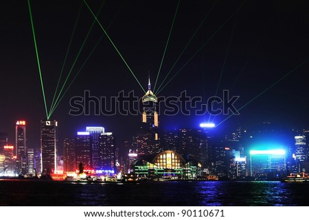 Skyline of Victoria Harbour in Hong Kong at night - stock photo